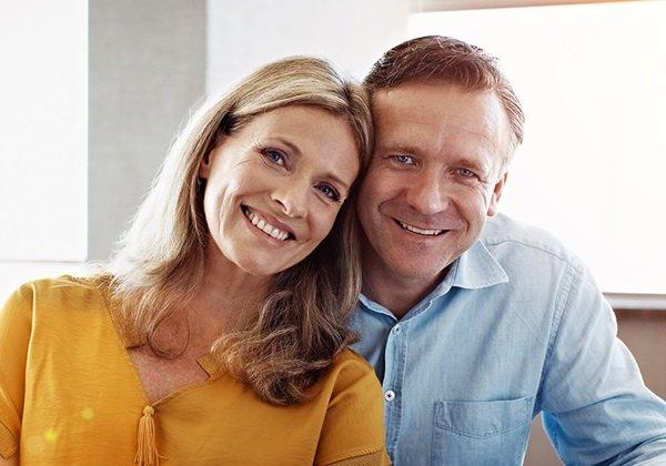 man woman smiling