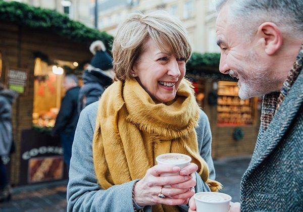 man woman holding coffee