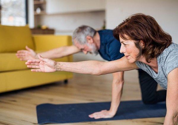 couple doing yoga at home