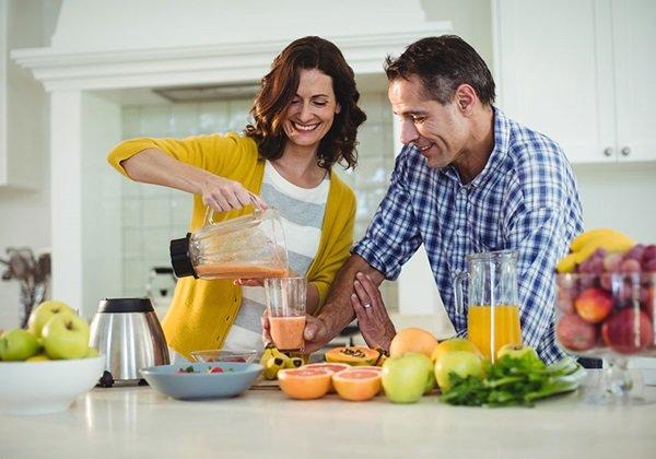 man woman having juice