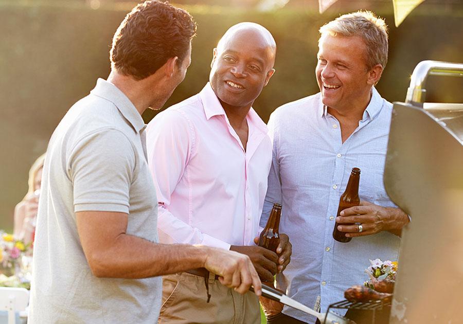 three men at a barbecue
