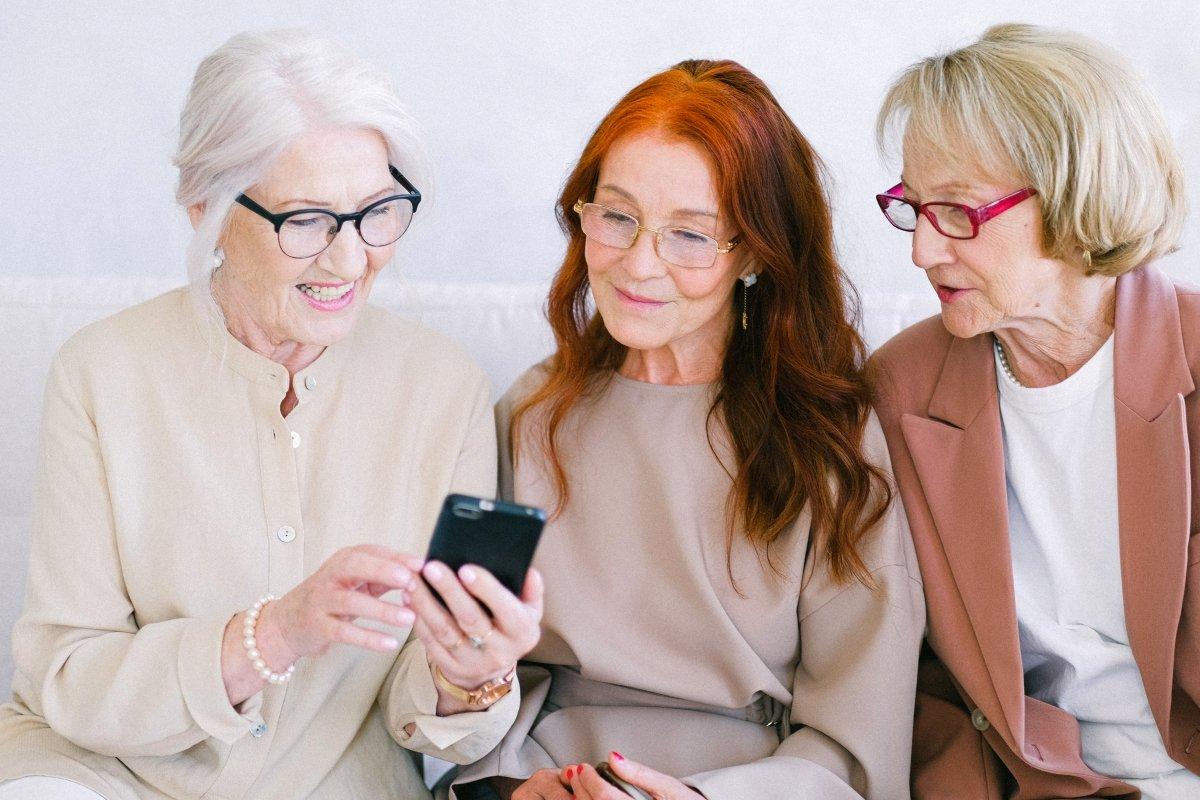 three senior women on phone video call
