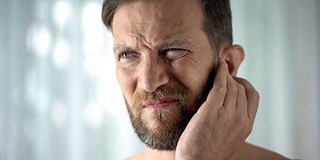 man with discomfort in his ears