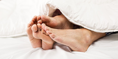 couple feet in bed