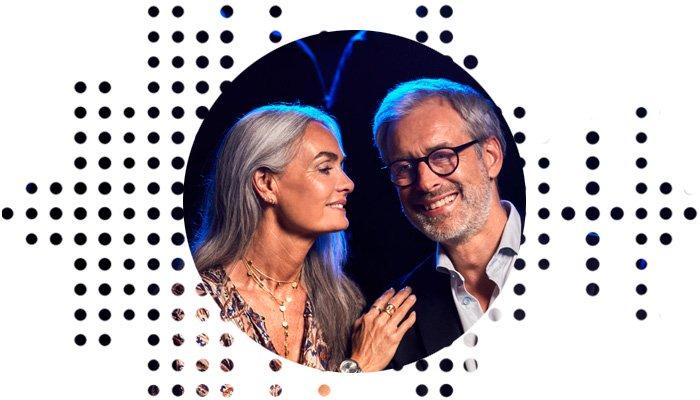 man and woman wearing hearing aids enjoying a show