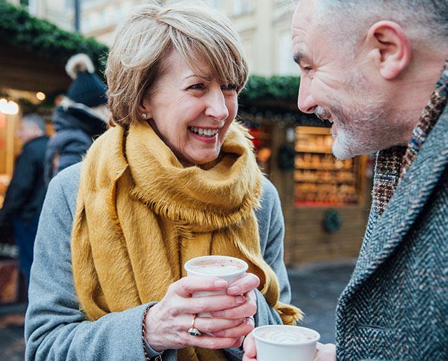 man-woman-outdoor-having-coffee