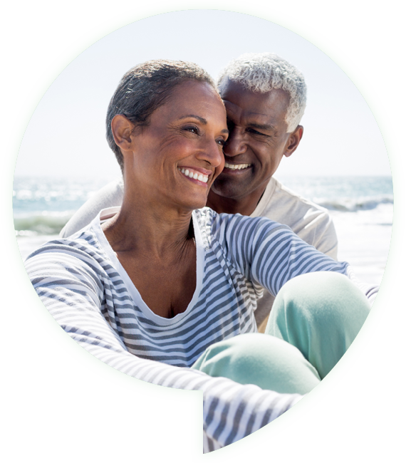 man and woman smiling on beach