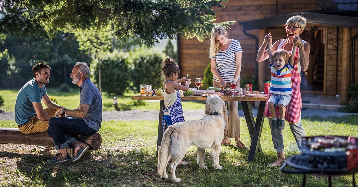 family enjoying outdoor bbq