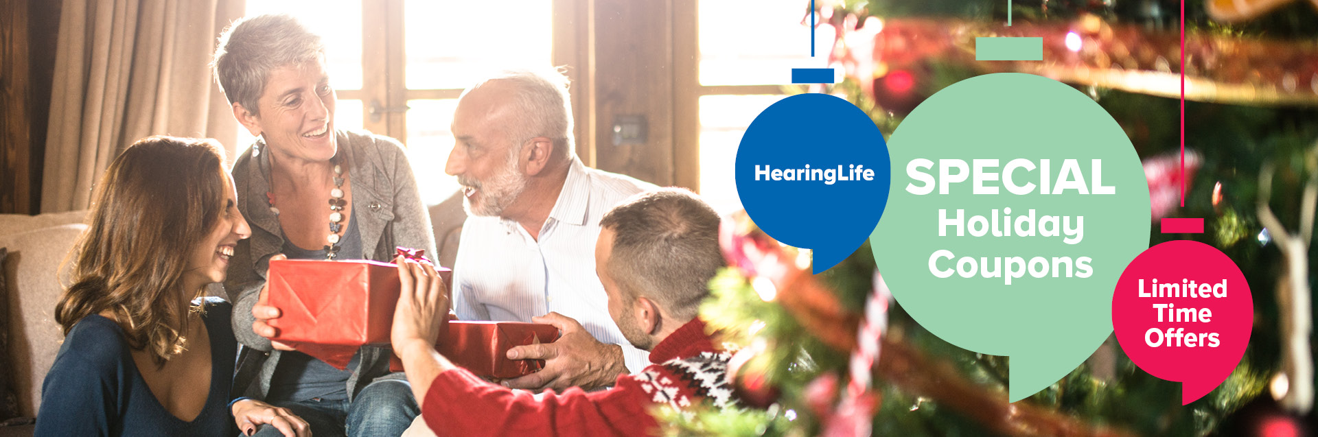 Hearing professional fitting a hearing aid in the ear of a smiling client.
