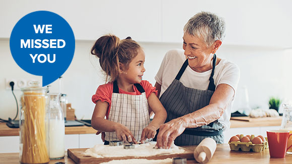 woman and grand daughter cooking together