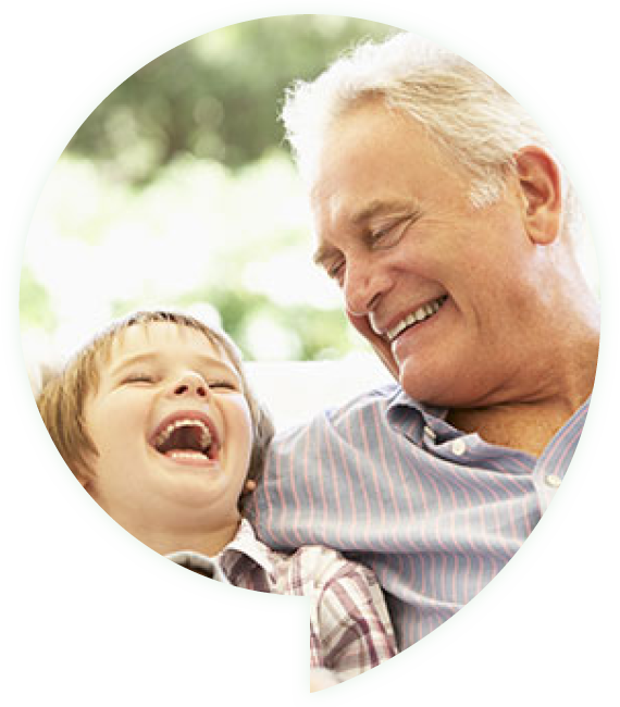 grandfather laughing with his grandson