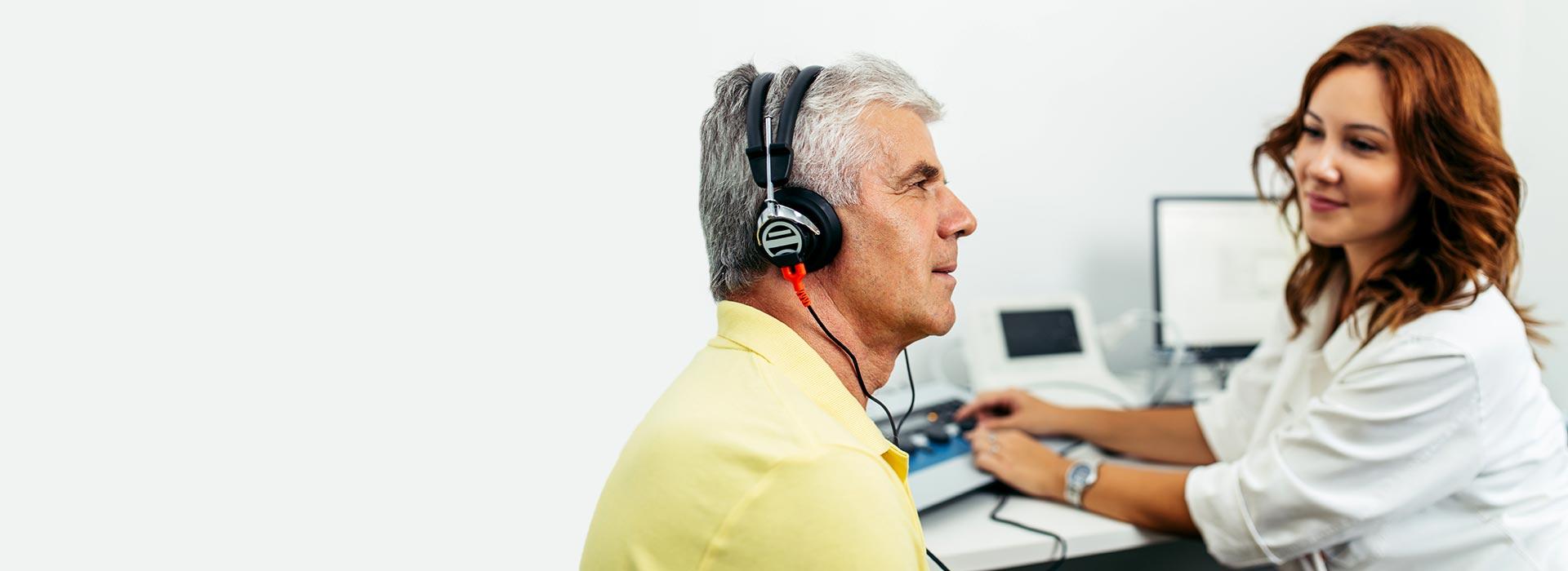 man-getting-hearing-test_1920x700