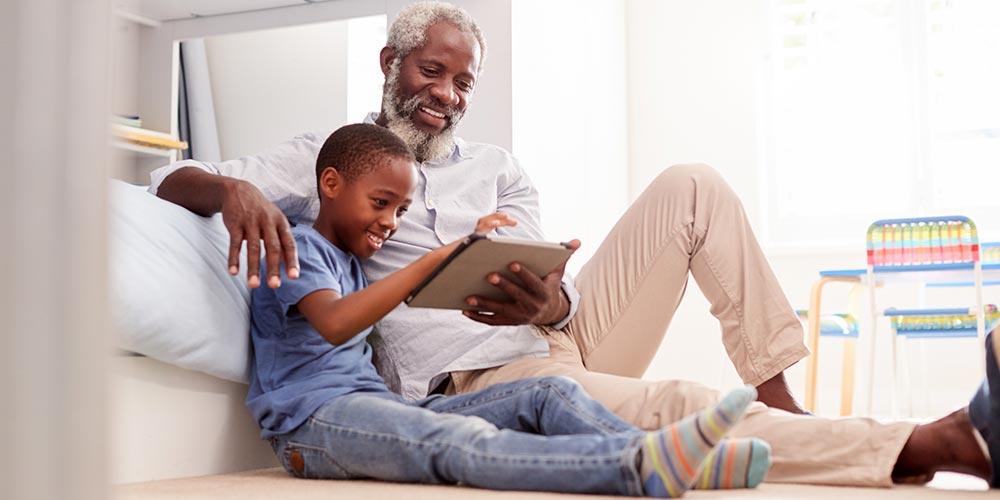 grandfather-grandson-tablet