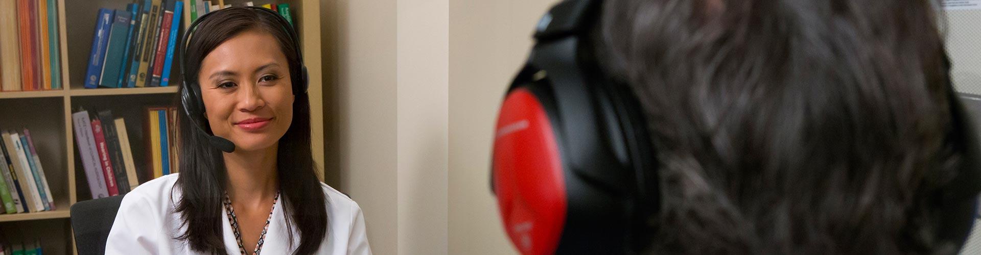 Audiologist testing patient