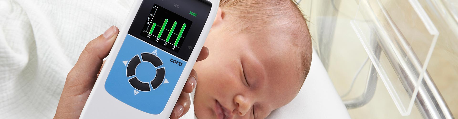 An infant being evaluated for otoacoustic emissions with the GSI Corti