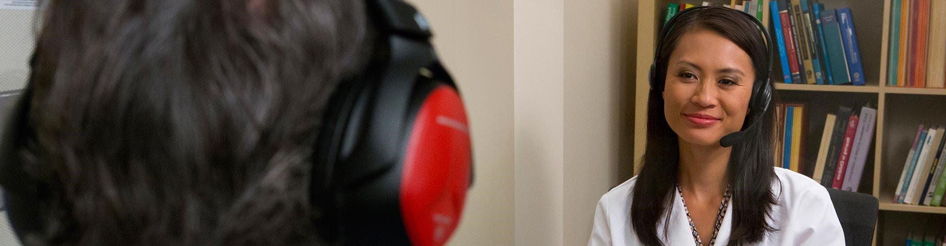 An audiologist testing a patient