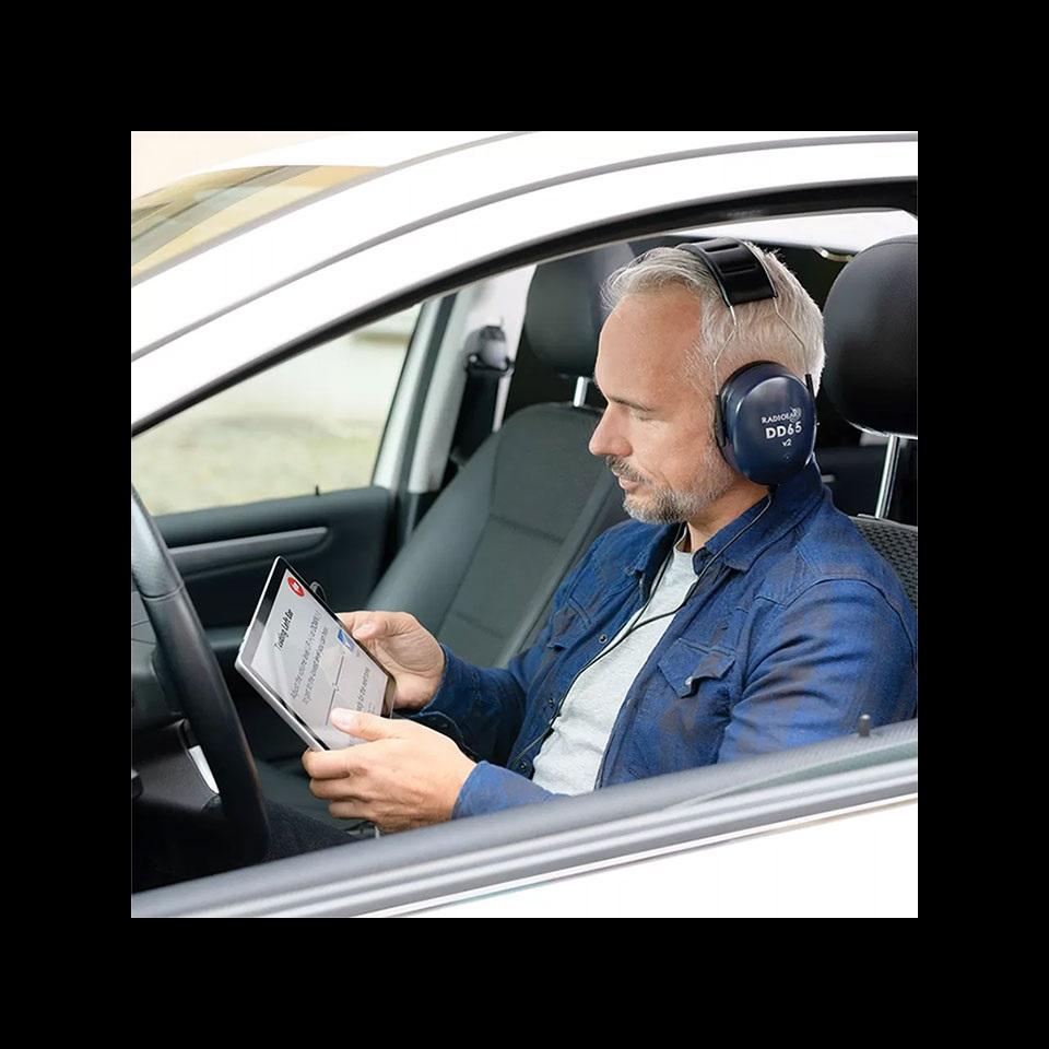 man-taking-hearing-test-in-car