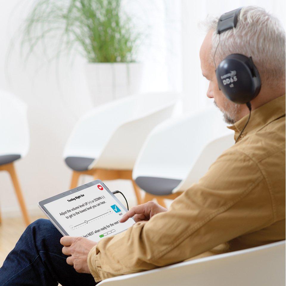 man-taking-hearing-test