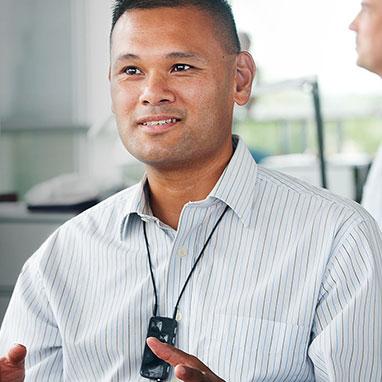Man wearing oticon connectline