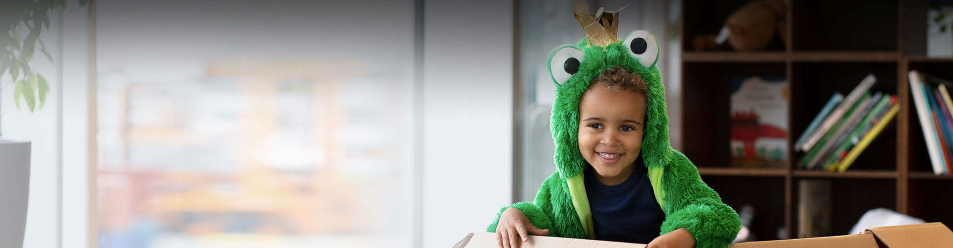 Child wearing Opn Play hearing aids in a costume