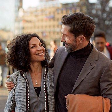 Man wearing Opn S hearing aids talking with woman