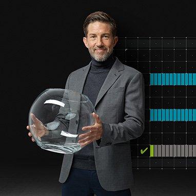 Man wearing Oticon hearing aids holding fish bowl