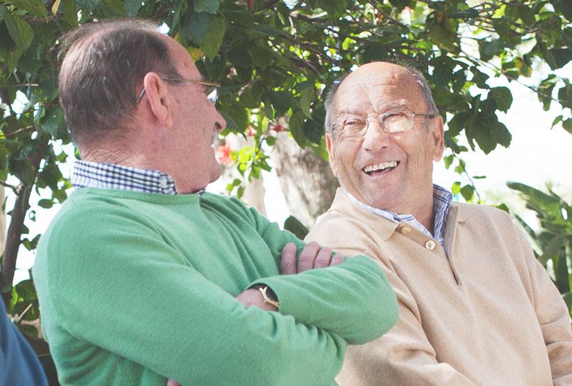 two older men talking